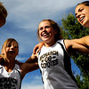 (From left to right) Monarch sophomore Virginia Spong, junior Mariel Fulton, and senior Rebecca Richmond cheer before the Liberty Bell Cross Country meet at Heritage High School in Littleton, Friday, Sept. 18, 2009. <br /> <br />  DAILY CAMERA/ Kasia Broussalian