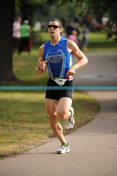 "<font size=""3"" face=""Verdana"" font color=""white"">2008 LifeTime Fitness Triathlon </font> <font size=""3"" face=""Verdana"" font color=""#5CB3FF"">Photos of the triathlon taken at Lake Nokomis in Minneapolis. The annual sporting event is part of the summer Minneapolis Aquatennial event. July 2008.</font> <br> <font size = ""1"" font color = ""gray"">Click on photo to see larger size.</font>"