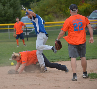 The Benchwarmers' Jordan Carter runs into Lil' Truckahs second baseman Justine Flagg as she makes a play for a wild throw. (Paula Roberts photo)