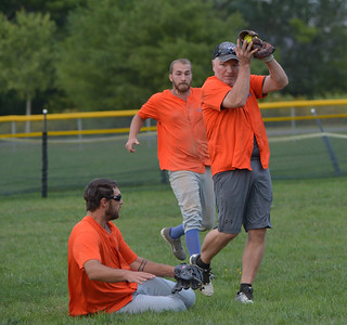 Shortstop Tom Nelson makes a catch for the Lil' Truckahs in traffic with outfielders Daniel Arsenault and Brandon Soper. (Paula Roberts photo)