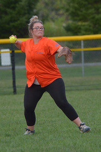 Desiree Benner throws to the infield for the Lil' Truckahs. (Paula Roberts photo)