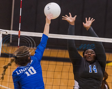 Lindale's Jaci Philpot (10) spikes the ball as John Tyler defenders Kassity McKenzie (14) and Treasure Coleman (7) during 5A bi-district playoff action Tuesday, Nov. 5, 2019, at Wagstaff Gymnasium in Tyler. (Cara Campbell/Tyler Morning Telegraph)