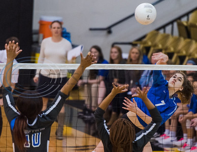 Lindale's Shelbi Steen (7) spikes the ball past John Tyler defenders Patrianna Pettigrew (10) and Michia McFarland (8) during 5A bi-district playoff action Tuesday, Nov. 5, 2019, at Wagstaff Gymnasium in Tyler. (Cara Campbell/Tyler Morning Telegraph)