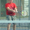 Rushville's Michael St. John hits a backhand return.
