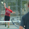 Rushville's Adam Martin serves during action at the Richard Bradley Tennis Center.