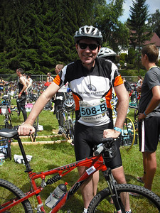 Our group  included a few relay teams.  In the relay, one person swims, a second person bikes, and a third person runs.  Here's Jeff getting ready for the bike portion.