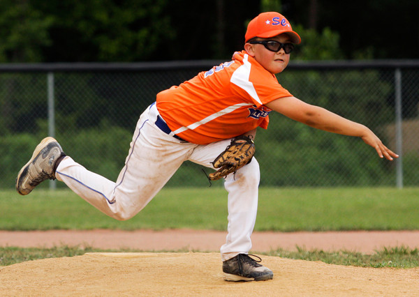 Silver Creek's Dylan Murphy pitches during the fourth inning of their game against Clarksville in the District V Little League All-Star tournament in Charlestown on Tuesday evening. Silver Creek won the game in four innings, 12-0. Staff photo by Christopher Fryer