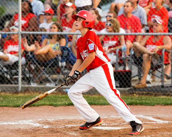 Jeff/GRC's Bailey Falkenstein connects for a home run during the second inning of their game against Charlestown in the 12-year-old District V Little League All-Star tournament in Charlestown on Tuesday night. Staff photo by Christopher Fryer