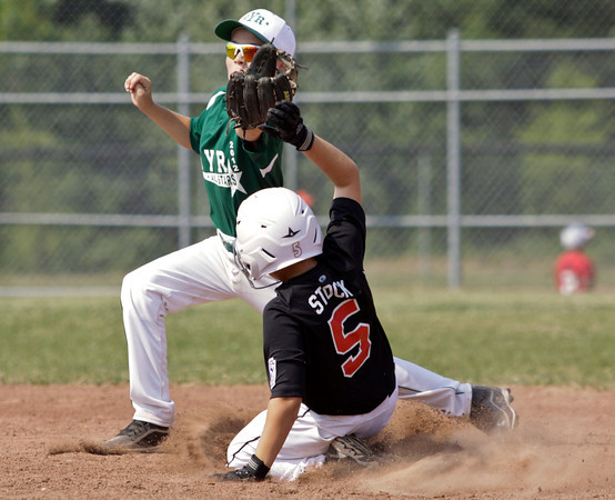 New Albany's Ben Stock slides safely into second base past Highlander Youth Recreation shortstop Aaron Brown in the fifth inning of their game during the 11-year-old District V Little League All-Star tournament in Charlestown on Saturday afternoon. HYR won the game 12-5. Staff photo by Christopher Fryer