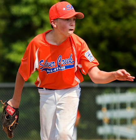 Silver Creek's Brandon Schafer pitches during the fifth inning of their game against New Albany in the District V Little League All-Stars tournament in Charlestown on Saturday afternoon. Silver Creek won the game 9-8. Staff photo by Christopher Fryer