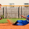 Charlestown's Brooke Adams slides safely into second base as Hebron's Sasha Pass struggles to control the ball during the fifth inning of their game in the state finals at Clarksville Little League Park on Saturday evening. Charlestown won the game in eight innings, 9-8. Staff photo by Christopher Fryer