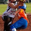 Silver Creek's Elayna Balingit collides with New Albany's Madison Lawson at third base during the third inning of their championship game in the 9 to 10-year-old District V Little League All-Star tournament in Charlestown on Saturday evening. Lawson dropped the ball during the collision and Balingit was safe. Silver Creek won the game 15-7. Staff photo by Christopher Fryer