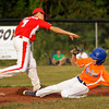 Jeff/GRC's Bailey Falkenstein attempts a double play after tagging out Silver Creek's Bryson McNay at second during the fifth inning of their game in the 12-year-old District V Little League All-Star tournament in Charlestown on Thursday evening. Jeff/GRC won the game in five innings, 14-2. Staff photo by Christopher Fryer