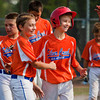 Silver Creek's Dylan Godlett, left, and Elijah Bays celebrate their victory over New Albany in the District V Little League All-Stars tournament in Charlestown on Saturday afternoon. Bays hit a triple in the sixth inning, then came in to score the winning run on a New Albany error during the same play. Silver Creek won the game 9-8. Staff photo by Christopher Fryer