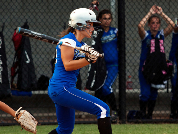 Charlestown's Leah Sherrill connects for a triple during the eighth inning of their game against Hebron in the state finals at Clarksville Little League Park on Saturday evening. Charlestown won the game in eight innings, 9-8. Staff photo by Christopher Fryer