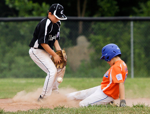 Silver Creek's Connor Young slides safely into second base as Clarksville's Joey Stamper struggles to control the ball during the fourth  inning of their game in the District V Little League All-Star tournament in Charlestown on Tuesday evening. Silver Creek won the game in four innings, 12-0. Staff photo by Christopher Fryer