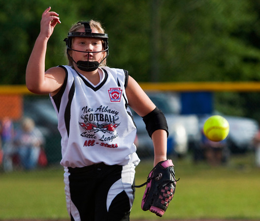 New Albany's Dani Grant pitches against Silver Creek during the second inning of their championship game in the 9 to 10-year-old District V Little League All-Star tournament in Charlestown on Saturday evening. Silver Creek won the game 15-7. Staff photo by Christopher Fryer