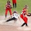 New Albany's Madison Lawson slides safely into second base past Jeff/GRC's Madison Bush, right, and Megan Ekart during the first inning of their game at the District V Little League All-Star tournament in Charlestown on Tuesday night. Staff photo by Christopher Fryer