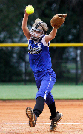 Charlestown's Taylor Glover pitches during the fifth inning of their game against Zionsville in the state finals at Clarksville Little League Park on Thursday evening. Charlestown won the game in 5 innings, 15-1. Staff photo by Christopher Fryer