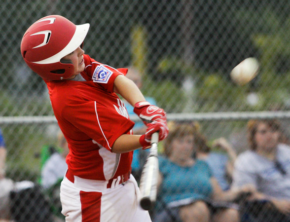 Jeffersonville/GRC's Bradley Benton connects for a grand-slam home run during the second inning of their game against Charlestown in the 12-year-old District V Little League All-Star tournament in Charlestown on Tuesday night. Staff photo by Christopher Fryer