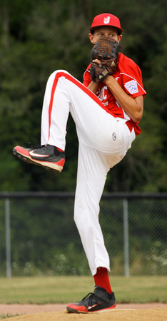 Jeff/GRC's Gerrin Moore pitches during the first inning of their game against Silver Creek in the 12-year-old District V Little League All-Star tournament in Charlestown on Thursday evening. Jeff/GRC won the game in five innings, 14-2. Staff photo by Christopher Fryer