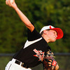 New Albany's Cooper Biven pitches during their championship game against Jeff/GRC in the 9-10-year-old District V Little League All-Star tournament in Charlestown on Monday evening. New Albany won the game, 22-0. Staff photo by Christopher Fryer