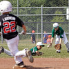Highlander Youth Recreation shortstop Aaron Brown and outfielder Blake Barrett, right, scramble for a loose ball in the fifth inning of their game against New Albany during the 11-year-old District V Little League All-Star tournament in Charlestown on Saturday afternoon. HYR won the game 12-5. Staff photo by Christopher Fryer