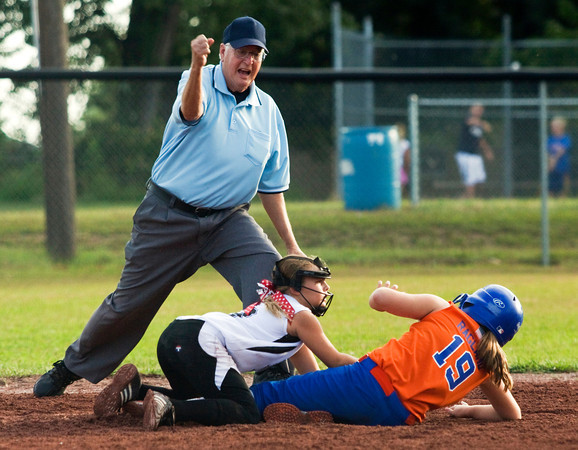 New Albany's Madison Lawson tags Silver Creek's Mazden Ragland out at second during the third inning of their championship game in the 9 to 10-year-old District V Little League All-Star tournament in Charlestown on Saturday evening. Silver Creek won the game 15-7. Staff photo by Christopher Fryer