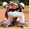 Silver Creek's Caleb Oakes and New Albany's Thomas Ogden collide at third base during the fifth inning of their game in the District V Little League All-Stars tournament in Charlestown on Saturday afternoon. Ogden lost control of the ball and Oakes was safe. Silver Creek won the game 9-8. Staff photo by Christopher Fryer