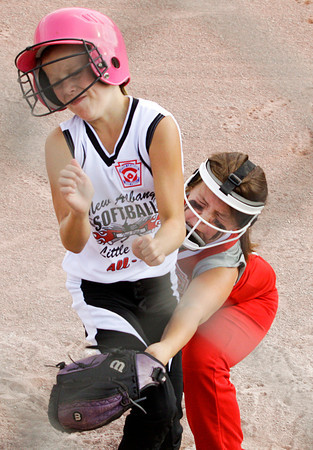 New Albany's Kelsi Sogge collides with Jeff/GRC's Mollie Davis at home plate during the first inning of their game at the District V Little League All-Star tournament in Charlestown on Tuesday night. Sogge was safe, scoring New Albany's second run of the game. Staff photo by Christopher Fryer