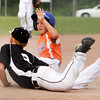 Silver Creek's Kyle Snell slides safely into third base past Clarksville's Colin Brown during the fourth inning of their game in the District V Little League All-Star tournament in Charlestown on Tuesday evening. Silver Creek won the game in four innings, 12-0. Staff photo by Christopher Fryer
