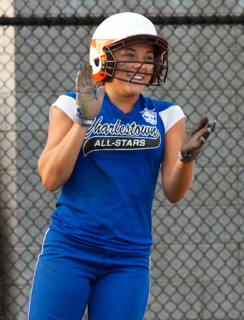 Charlestown's Lexi Logsdon smiles after scoring the winning run during their game against Hebron in the state finals at Clarksville Little League Park on Saturday evening. Charlestown won the game in eight innings, 9-8. Staff photo by Christopher Fryer