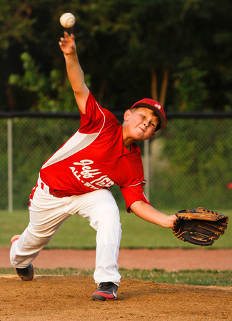 Jeff/GRC's Ben Harbeson pitches during the fourth inning of their championship game against New Albany in the 9 to 10-year-old District V Little League All-Star tournament in Charlestown on Monday evening. New Albany won the game, 22-0. Staff photo by Christopher Fryer