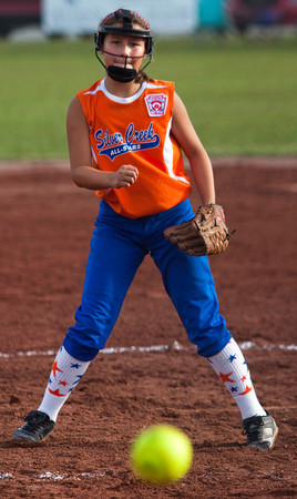Silver Creek's Bailey Cravens pitches against New Albany during the second inning of their championship game in the 9 to 10-year-old District V Little League All-Star tournament in Charlestown on Saturday evening. Silver Creek won the game 15-7. Staff photo by Christopher Fryer