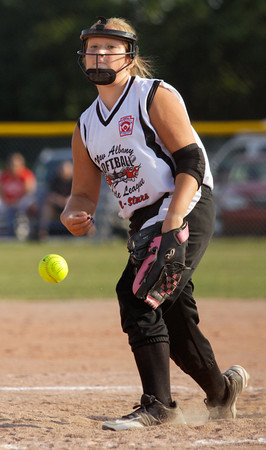 New Albany's Dani Grant pitches during the third inning of their game against Jeff/GRC at the District V Little League All-Star tournament in Charlestown on Tuesday night. Staff photo by Christopher Fryer
