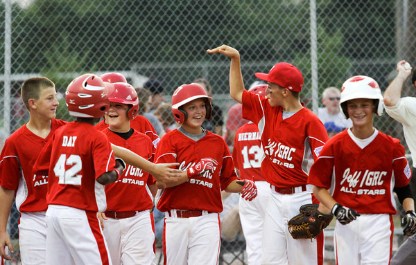 Jeffersonville/GRC's Bradley Benton is congratulated by his teammates after hitting a home run during the second inning of their game against Charlestown in the 12-year-old District V Little League All-Star tournament in Charlestown on Tuesday night. Staff photo by Christopher Fryer