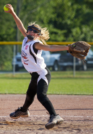 New Albany's Taylor Luckhardt pitches in the fourth inning of their game against Clarksville during the District V Little League All-Star Tournament in Charlestown on Thursday evening. New Albany won the game 9-2. Staff photo by Christopher Fryer