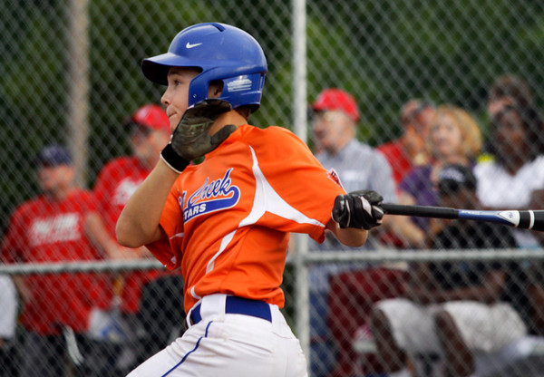 Silver Creek's Bryson McNay connects for a RBI home run during the third inning of their game against Jeff/GRC in the 12-year-old District V Little League All-Star tournament in Charlestown on Thursday evening. Jeff/GRC won the game in five innings, 14-2. Staff photo by Christopher Fryer