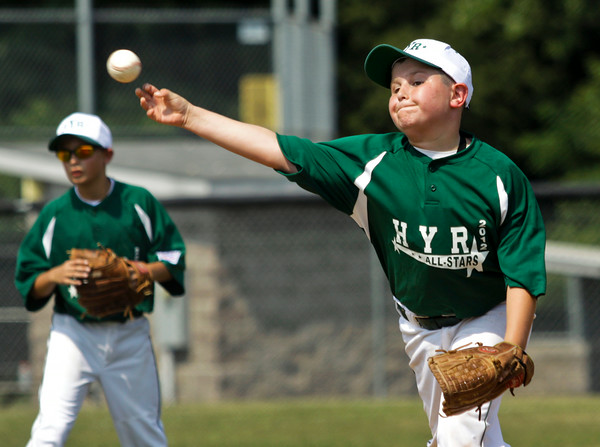 Highlander Youth Recreation's Kellen Northam pitches in the fourth inning of their game against New Albany during the 11-year-old District V Little League All-Star tournament in Charlestown on Saturday afternoon. HYR won the game 12-5. Staff photo by Christopher Fryer