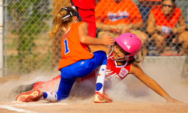 Silver Creek pitcher Jordan Balz tags out Jeff/GRC's Kaylee Ellis at home plate to end the first inning of their game in the 10-year-old District V Little League All-Star tournament in Charlestown on Friday evening. Staff photo by Christopher Fryer