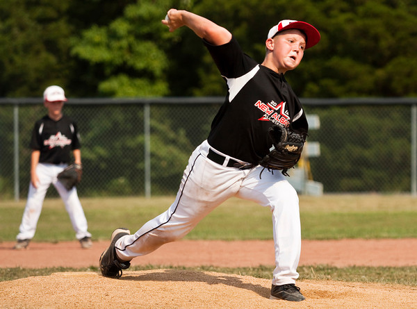 New Albany's Dylan Clark pitches during the sixth inning of their game against Silver Creek in the District V Little League All-Stars tournament in Charlestown on Saturday afternoon. Silver Creek won the game 9-8. Staff photo by Christopher Fryer