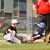 New Albany's Ray Reisinger tags out Terre Haute North's Jace Ross during the fourth inning of their game in the Minor Baseball State Tournament at John and Shirley Woehrle Field in Jeffersonville on Saturday. New Albany won the game, 12-3. Staff photo by Christopher Fryer