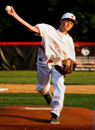 Jeff/GRC's Ethan English pitches during their game against New Albany in the 11-12-year-old District 5 championship game at Mt. Tabor Park in New Albany on Tuesday. Jeff/GRC won the game, 12-3. Staff photo by Christopher Fryer