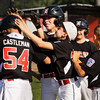 New Albany's Josh Castleman is congratulated by his teammates after hitting a two-run-homer during the second inning of their game against HYR at Mt. Tabor on Thursday. New Albany won the game in four innings, 17-2. Staff photo by Christopher Fryer