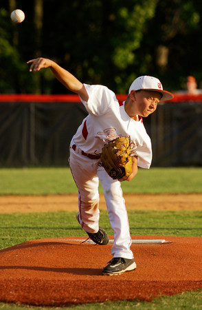 Jeff/GRC's Gavin Seebold pitches during their game against New Albany in the 9-10-year-old District 5 championship game in New Albany on Saturday. New Albany won the game, 3-0. Staff photo by Christopher Fryer