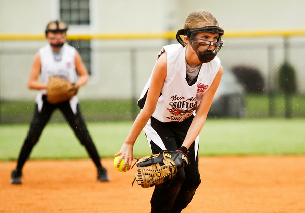 New Albany's Maggie Jo Foreman pitches during their 15-3 loss to Jeff/GRC in the semifinal round of the Little League 9-10-year-old softball state finals in Clarksville on Tuesday. Staff photo by Christopher Fryer