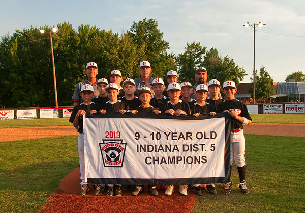 New Albany holds their championship banner following their 3-0 victory over Jeff/GRC in the 9-10-year-old District 5 championship game in New Albany on Saturday. Staff photo by Christopher Fryer