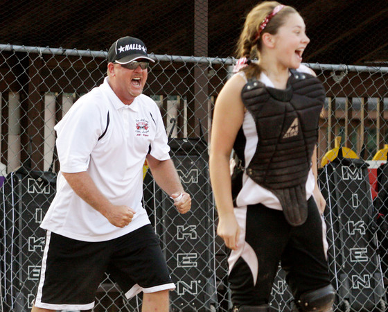 New Albany's head coach Darrell Thomas celebrates his team's 5-2 victory over Silver Creek in the District 5, 11-12-year-old softball championship game at Grant Line Elementary School on Tuesday. Staff photo by Christopher Fryer