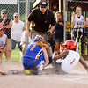 New Albany's Ariahna McNeary collides with Silver Creek pitcher Abby Whitlock at home plate during the fourth inning of the District 5, 11-12-year-old softball championship game at Grant Line Elementary School on Tuesday. McNeary was safe on the play and New Albany won the game, 5-2. Staff photo by Christopher Fryer