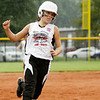 New Albany's Alexia Flannery makes her way to third base during their 15-3 loss to Jeff/GRC in the semifinal round of the Little League 9-10-year-old softball state finals in Clarksville on Tuesday. Staff photo by Christopher Fryer